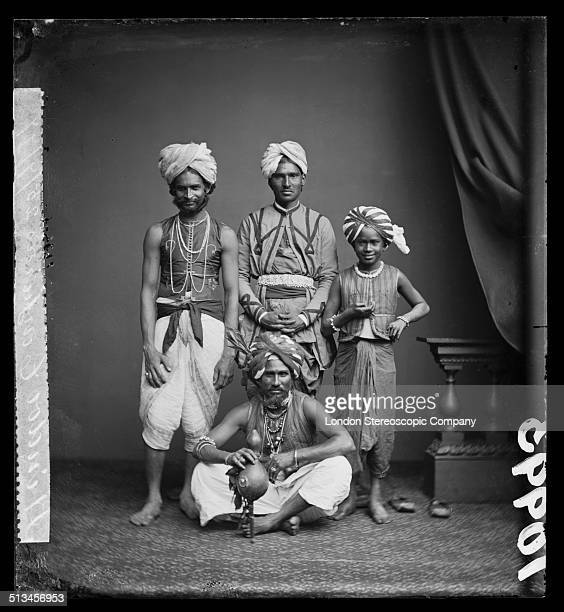 A group of indian conjurors one of whom is holding a holding a pungi 25th July 1877 The man on the left is presumed to be the well known conjurer and...