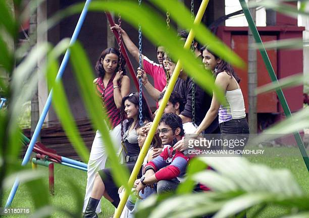 A group of Indian models pose during a photo shoot as they compete in an early stage of a beauty pageant in Calcutta 17 August 2004 Modeling as a...