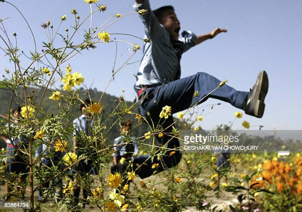 A group of Indian orphans play during a class break at The Carmel Jyoti Missionary School in Imphal on November 17 2008 Many of the 33 children in...