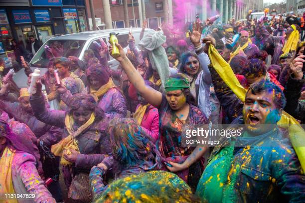 A group of Indian people are seen throwing coloured powders during the celebration Millions of people around the world celebrate the annual Holi...