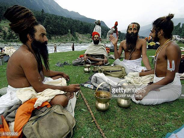 Group of Indian Sadhu's take a rest in Pahalgam some 55 kms east of Srinagar, 15 July 2004, during the annual pilgrimage to a shrine at Amarnath....
