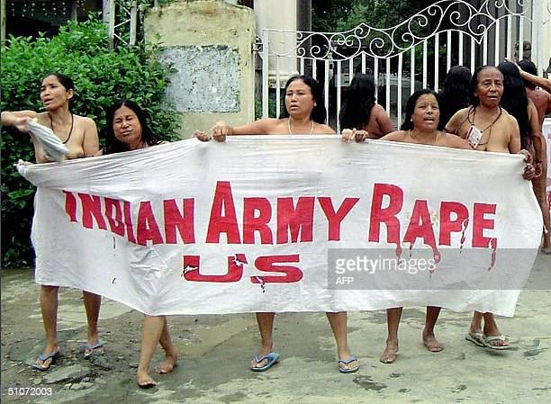 A group of Indian women hold aloft a banner as they stand naked outside the headquarters of the Assam Rifles paramillitary force in Imphal the...