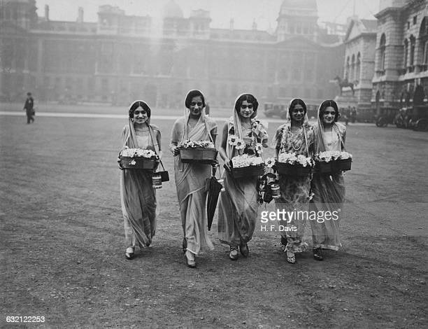 A group of Indian women selling paper roses for the Alexandra Rose Day charity fundraising event Whitehall London 12th June 1929 Left to right Miss...