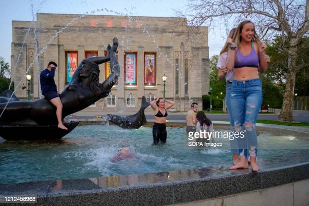 Group of Indiana University students who just finished graduating from the Kelley School of business during a video ceremony this weekend celebrate...