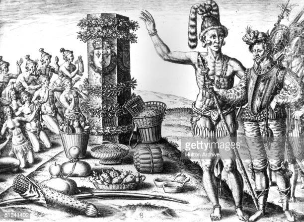 1591 A group of Indians kneeling and worshipping a column set up by Landanniero with offerings of cocoa and other fruit