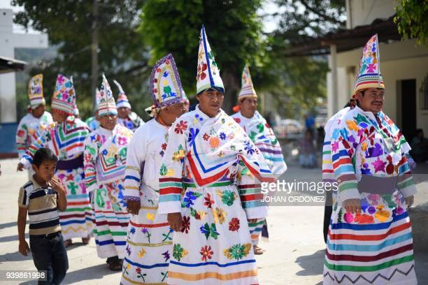 A group of indigenous men representing the 12 apostles get ready before the passage of Justo Juez procession within Holy Week celebrations in...