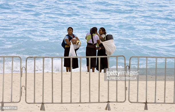 Group of indigenous women stand on the beach in the surroundings of the hotel where the World Economic Forum on Latin America is taking place in...