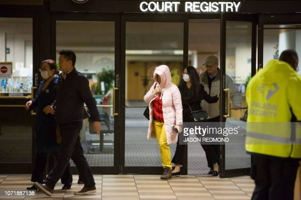 A group of individuals exits the court registry following the bail hearing of Huawei Technologies Chief Financial Officer Meng Wanzhou at British...