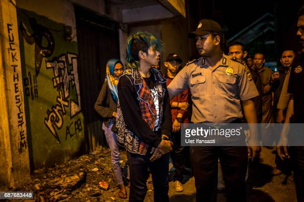 A group of Indonesian punks are escorted after being arrested for dressing as punks which goes against the prevailing sharia law during night patrol...