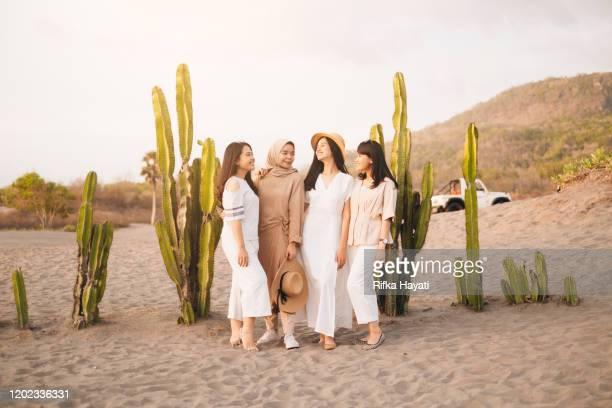 group of indonesian women happily together at gumuk pasir, yogyakarta - rifka hayati stock pictures, royalty-free photos & images