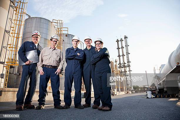 Group of industrial workers at chemical plant