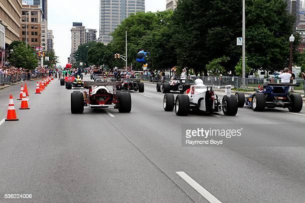 A group of Indy Cars makes their way South on Pennsylvania Street during the Indianapolis 500 Festival Parade in downtown Indianapolis Indiana on May...