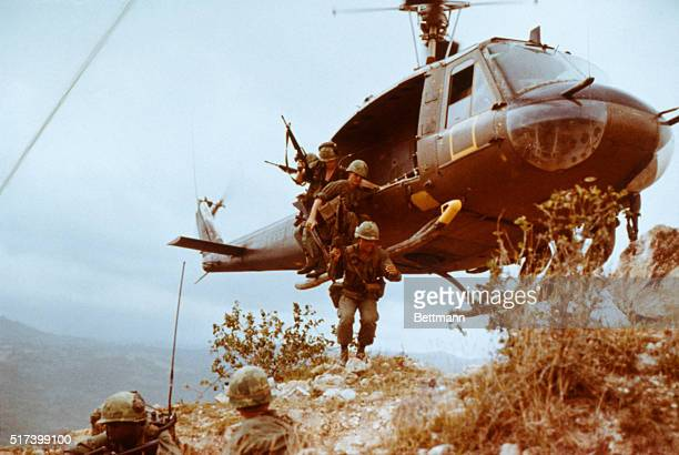 """Group of infantrymen from the 1st Cavalry Division jump from a Bell UH-1 Iroquois, also known as a """"Huey"""", as they begin a reconnaissance mission in..."""