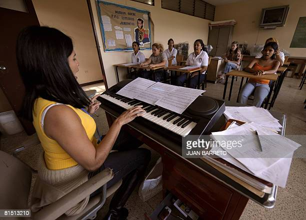 A group of inmates of the women's prison Instituto Nacional de Orientacion Femenina attend singing lessons on June 10 2008 inside the prison in the...