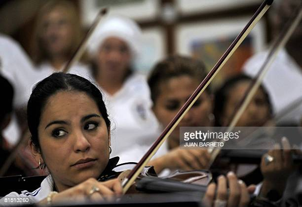 A group of inmates of the women's prison Instituto Nacional de Orientacion Femenina play the viola during music lessons on June 10 2008 inside the...