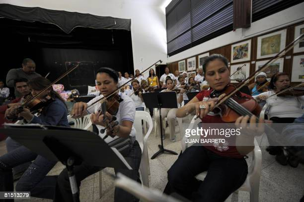 A group of inmates of the women's prison Instituto Nacional de Orientacion Femenina play the viola during music lessons inside the prison on June 10...
