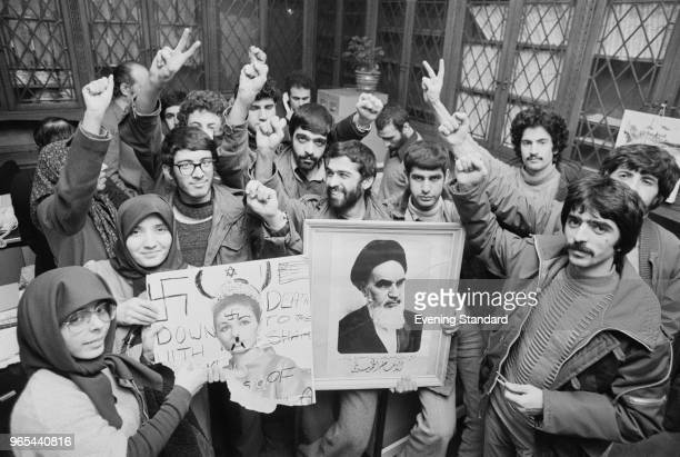 A group of Iranian antiPahlavi students holding pictures of Mohammad Reza Pahlavi and Farah Pahlavi celebrate the end of the Shah after the Iranian...