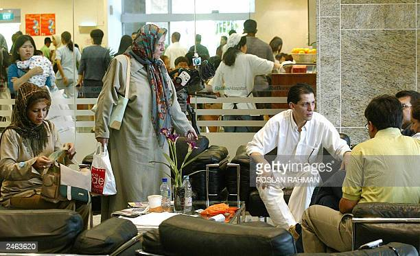 A group of Iranian wait at the lobby of Raffles Hospital for the update of the seperation of Iranian twin sisters Laden and Laleh Bijani in Singapore...