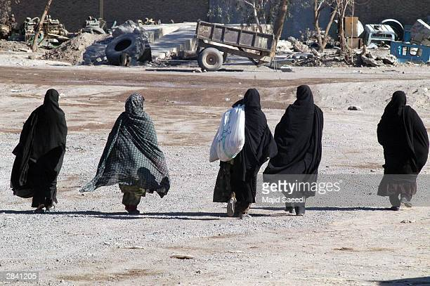 A group of Iranian woman walk down the street January 2 2003 in Bam Iran A week after a massive earthquake shattered Bam killing some 30000 people...
