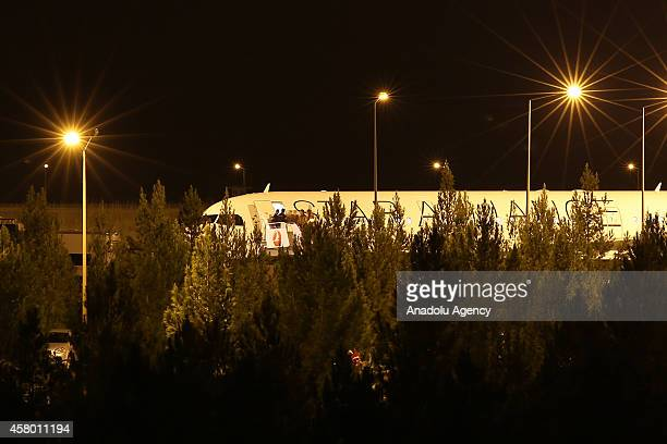 A group of Iraqi Kurdish Peshmerga forces who will travel onwards to the Syrian town of Kobani arrive at GAP Airport in Sanliurfa province of Turkey...