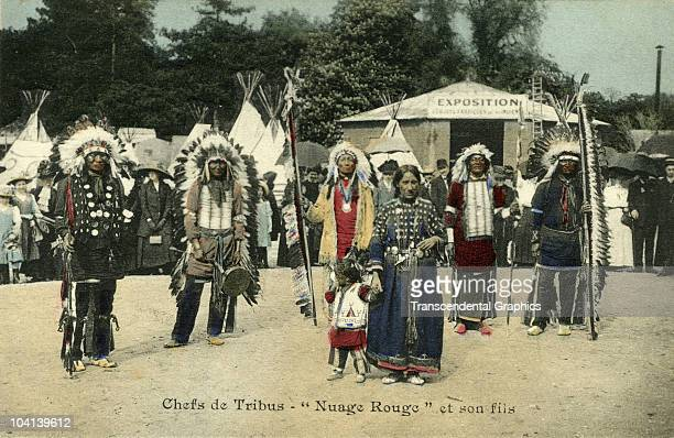 A group of Iroquois Native Americans pose at an Exposition for a portrait printed on a French postcard to promote a Wild West Show in France ca 1905
