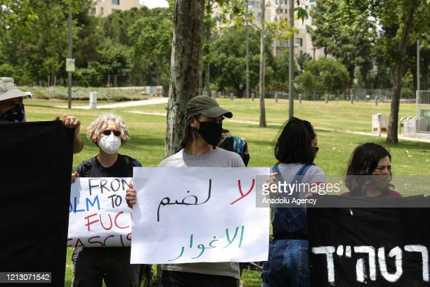 Group of Israeli activists, holding banners, gather in front of U.S Embassy as they stage a demonstration to protest against the annexation plan of...