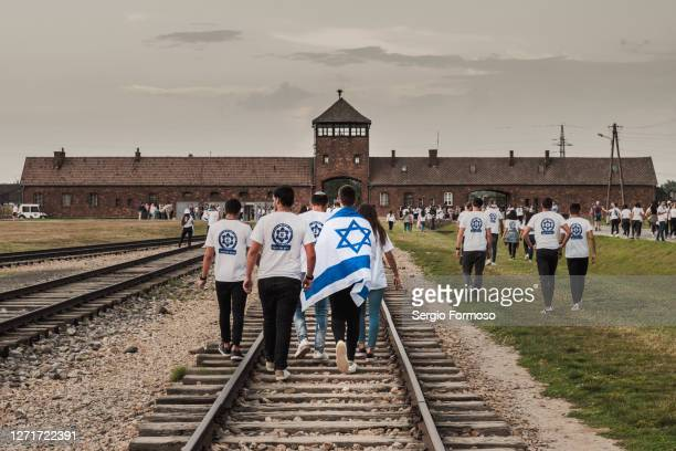 a group of israeli teenagers visit auschwitz-birkenau concentration camp, poland - birkenau stock pictures, royalty-free photos & images