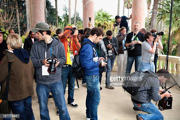 group of istock photographers working on a photo shoot - istock stock pictures, royalty-free photos & images
