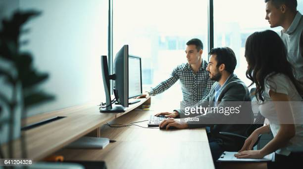 group of it experts in their office. - information technology support stock photos and pictures