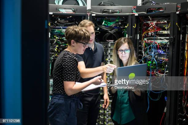 group of it technicians working in server room - server room stock pictures, royalty-free photos & images