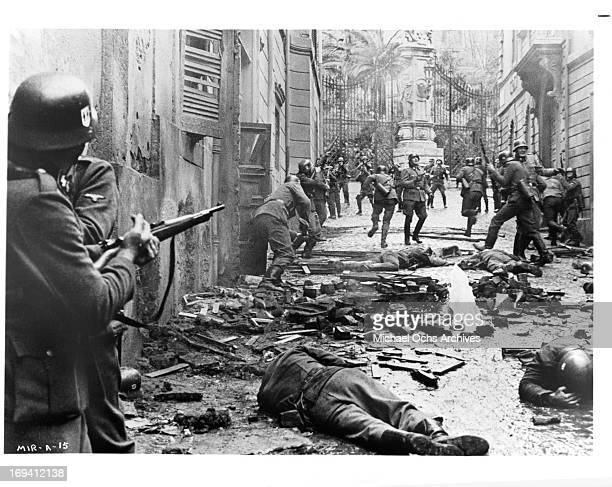A group of Italian partisans attack a column of SS soldiers in a scene from the film 'Massacre In Rome' 1973