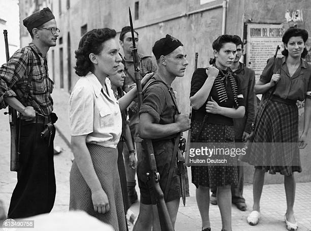 A group of Italian resistance fighters who helped South African troops in Pistoia to locate German snipers