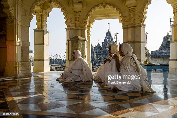 A group of Jain nuns is visiting a temple at Shatrunjaya hill one of the major pilgrim sites for Jains on the opening day of the yatra season
