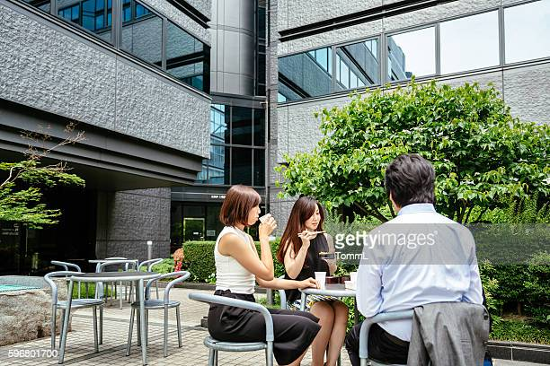 Group of japanese business people having lunch outdoor