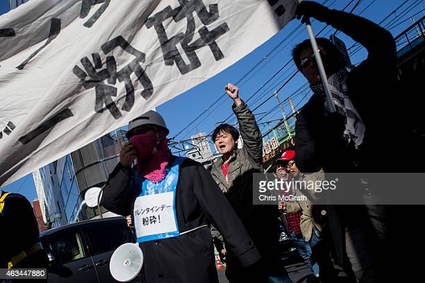 A group of Japanese men protest Valentines Day on February 14 2015 in Tokyo Japan The protest was organized by a group called Kakuhido meaning the...