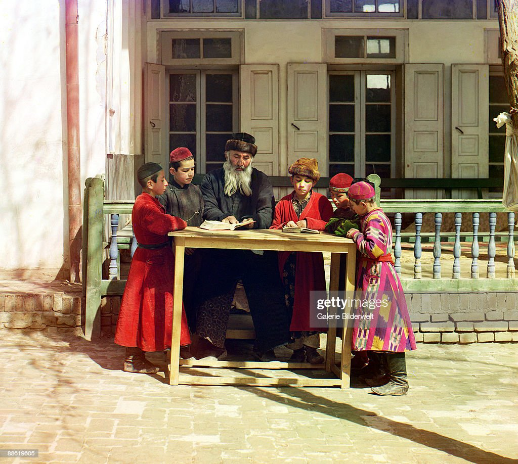 A group of Jewish boys, in traditional dress, studying with their teacher in Samarkand, Uzbekistan (then part of the Russian Empire), 1910.