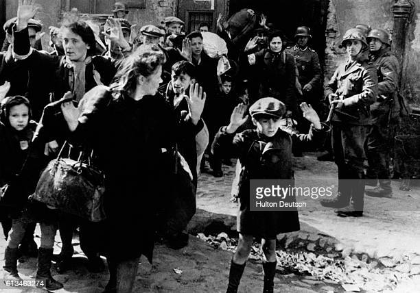 Frightened Jewish families surrender to Nazi soldiers at the Warsaw Ghetto in 1943 In January of that year the residents of the ghetto rose against...