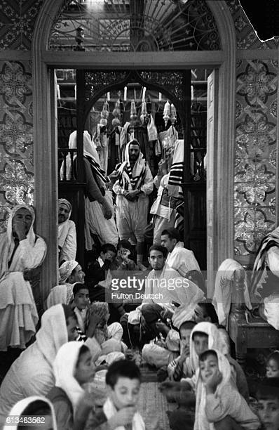 A group of Jewish people from an ancient community in Djerba in the Gulf of Gabes celebrate Simchat Torah or the Festival of the Bibles at a synagogue