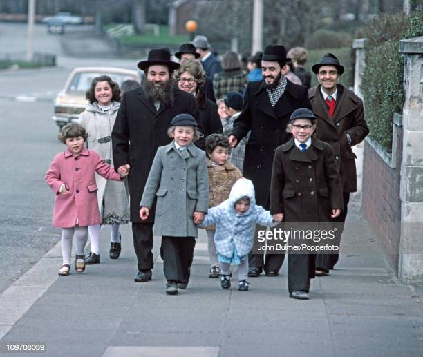 A group of Jewish people walking down a street in Manchester England in 1976
