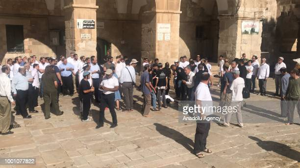 A group of Jewish settlers including children are forced into the compound accompanied by about 20 policemen Firas alDibis an official with...