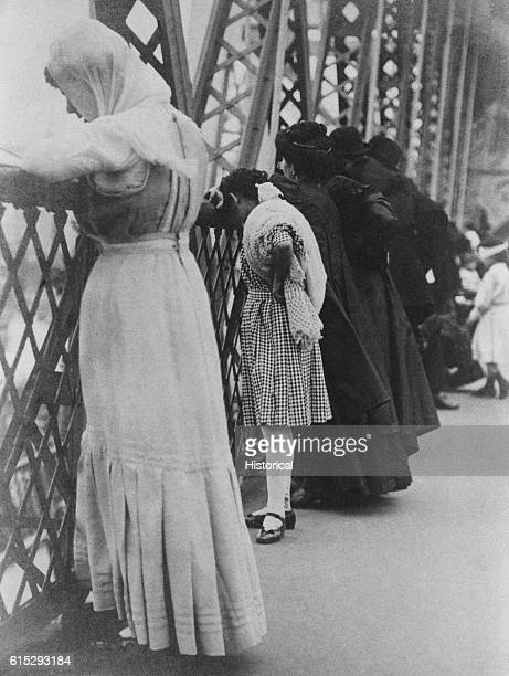 A group of Jews gather on the Brooklyn Bridge in New York City in 1909 to pray on the Jewish New Year
