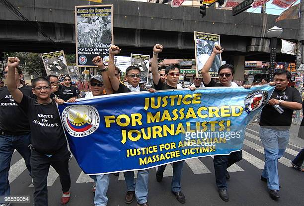 A group of journalist demand justice for 57 Amputuan massacre victims in Maguindanao during a rally in front of the Department of Justice building in...