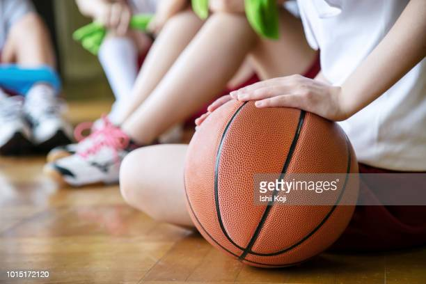 group of jr. high students making exercise in gymnastic hall - basketball sport stock pictures, royalty-free photos & images