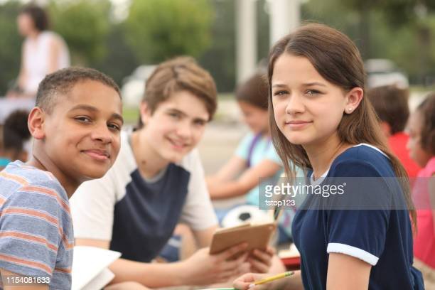 group of junior high school children, teenage friends studying on campus. - junior high student stock pictures, royalty-free photos & images