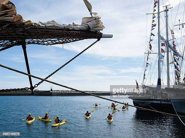 A group of kayakers paddle alongside the ships moored at the quay during the North Sea Tall Ships Regatta on August 27 2016 in Blyth England The...