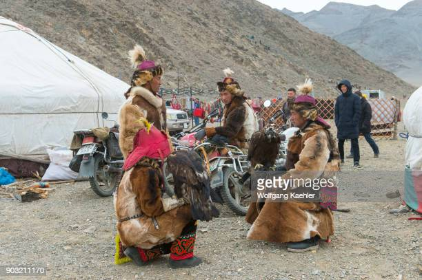 A group of Kazakh eagle hunters in the parking lot at the Golden Eagle Festival on the festival grounds near the city of Ulgii in the BayanUlgii...