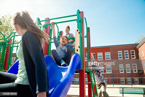 "group of kids active in school playground at recess.. - ""martine doucet"" or martinedoucet stock pictures, royalty-free photos & images"