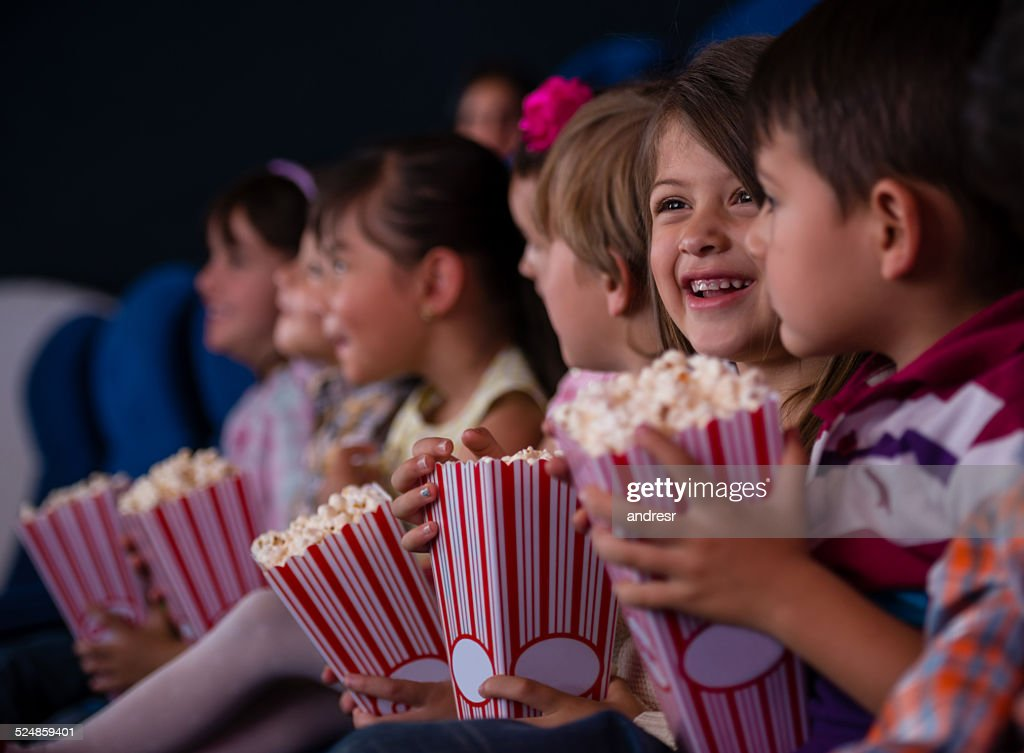 Group of kids at the cinema : Stock Photo