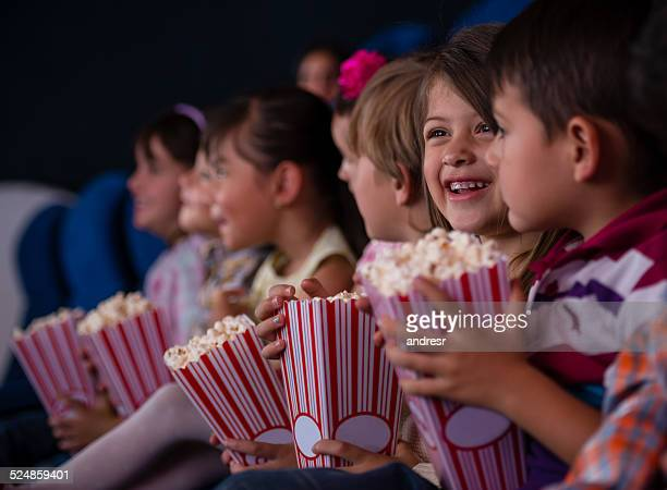 group of kids at the cinema - film industry stock pictures, royalty-free photos & images