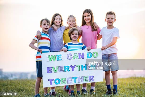 group of kids holds a message - propaganda stock pictures, royalty-free photos & images